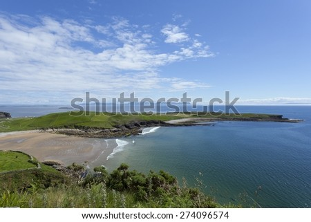 Scenic landscape photo of the Irish coastline in Muckross, Kilcar, Co. Donegal. View of Donegal bay with Benbulbin in the distance - stock photo