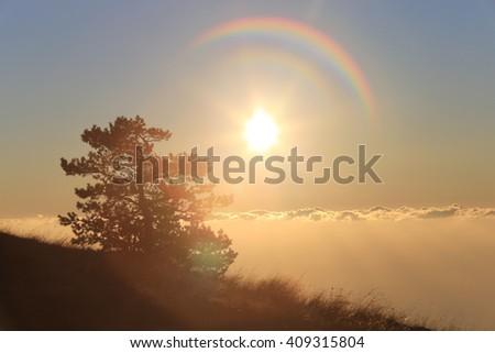 scenic landscape sun above the clouds in the mountains Demerdzhi Crimea  - stock photo