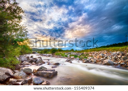 Scenic landscape view of a slow flow long exposure of South Boulder Creek at sunset in Rollinsville Colorado.   - stock photo