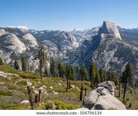 Scenic landscape view of Half Dome and Yosemite valley in Yosemite National Park - stock photo