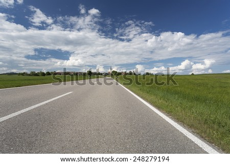 Scenic landscape with country road in Bavaria, Germany, in spring - stock photo