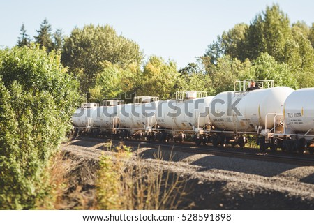 Scenic landscape with train tank cars