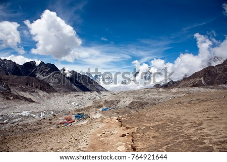 Scenic landscape with view to the village of Gorak Shep in the Himalayas, Nepal during the summer months with clear sky in the background