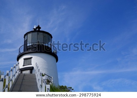 scenic Maine lighthouse on a beautiful summer's day - stock photo