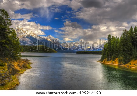 Scenic Maligne Lake and trout spawning river in the Canadian Rocky Mountains Jasper National Park, Alberta