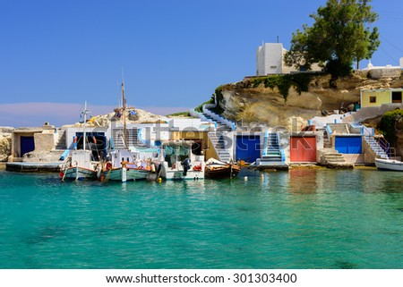Scenic Mandrakia village (traditional Greek village by the sea, the Cycladic-style) with sirmate - traditional fishermen's houses, Milos island, Cyclades, Greece. - stock photo