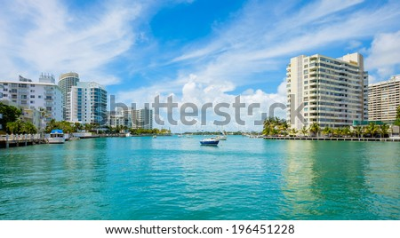 Scenic Miami Beach view along the Venetian Causeway with sailboats and condos along the bay. - stock photo