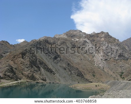 Scenic mountain and valley in stone desert of Kyrgyzstan. - stock photo