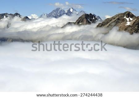 Scenic mountain landscape above cloud blanket in Aoraki National park in NZ. - stock photo