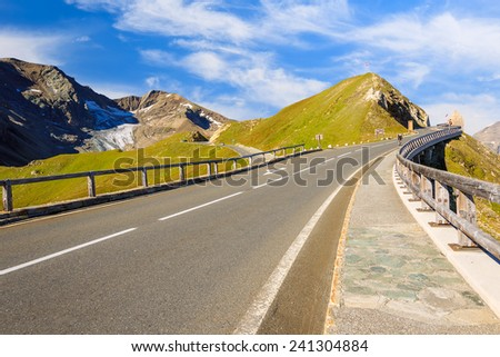 Scenic mountain road in Austrian Alps in summer time, Hohe Tauern National Park, Austria - stock photo