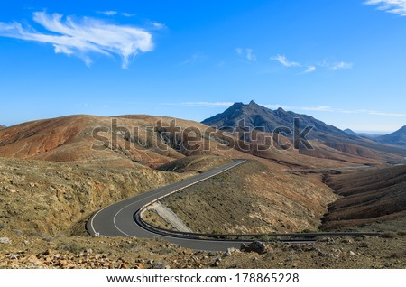 Scenic mountain road with volcano view near Tuineje village, Fuerteventura, Canary Islands, Spain