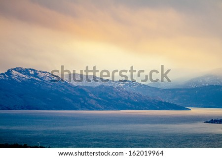 Scenic Mountain Sunset over Lake Okanagan - stock photo