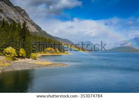 Scenic mountain views Rainbow over Kananaskis Lake Alberta Canada in summer - stock photo