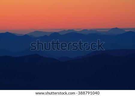 Scenic mountains view after sunset. From Mt. Hood, Cooper Spur. USA Pacific Northwest, Oregon. - stock photo
