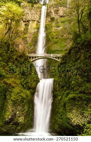 Scenic Multnomah Falls along the Columbia River in the Columbia River Gorge Oregon - stock photo
