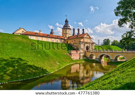 Scenic Nesvizh Castle in Belarus with reflections in water