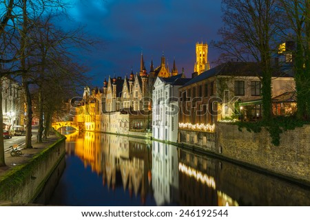 Scenic night cityscape with a medieval tower Belfort and the Green canal, Groenerei, in Bruges, Belgium - stock photo