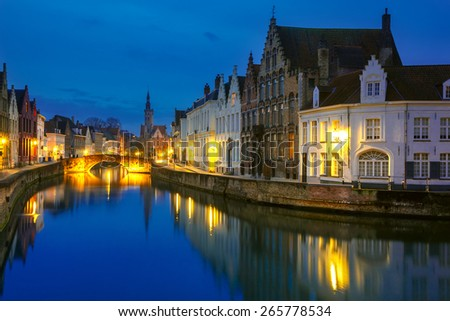 Scenic night cityscape with views of Spiegelrei and Jan van Eyckplein in Bruges, Belgium - stock photo