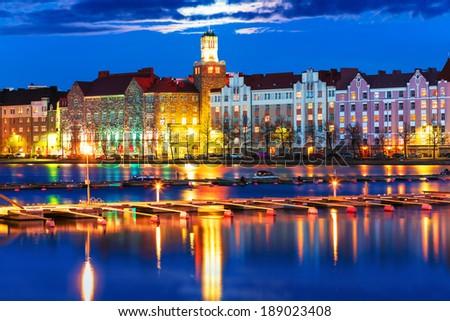 Scenic night panorama of sea pier illuminated architecture in Hakaniemi district in Helsinki, Finland - stock photo