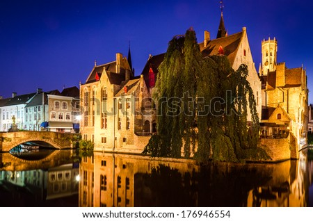 Scenic night view of river canal and medieval houses, Bruges, Belgium