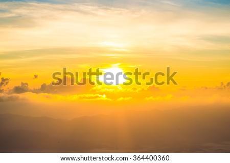 Scenic of orange sunrise sky background - stock photo