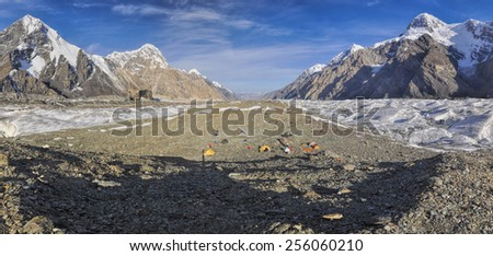 Scenic panorama of base camp on Engilchek glacier in picturesque Tian Shan mountain range in Kyrgyzstan - stock photo