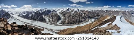 Scenic panorama of Fedchenko glacier in Pamir mountains in Tajikistan - stock photo