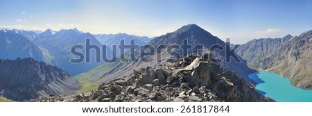 Scenic panorama of Tien-Shan mountain range in Kyrgyzstan - stock photo