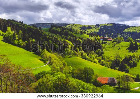 Scenic panoramic landscape: summer mountain valley with forests, fields and village in Germany, St. Ulrich, Black Forest - stock photo