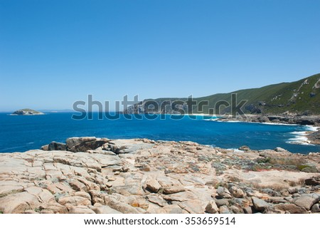 Scenic panoramic view along cliff coast of Torndirrup National Park, Albany, Western Australia, wild Southern Ocean, blue sky, copy space. - stock photo