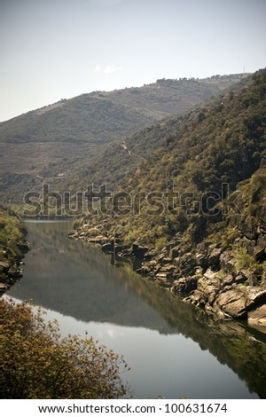 Scenic photo of the Douro Valley in Portugal vineyards in the mountains and the river Douro - stock photo