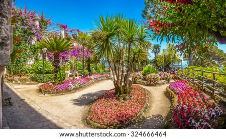 Scenic picture-postcard view of beautiful idyllic Villa Rufolo gardens in Ravello at famous Amalfi Coast with Gulf of Salerno, Campania, Italy - stock photo