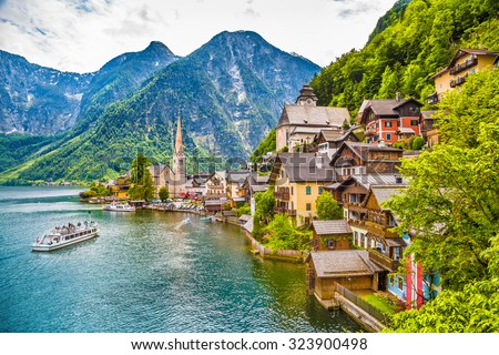 Scenic picture-postcard view of famous Hallstatt mountain village with Hallstaetter See in the Austrian Alps, region of Salzkammergut, Austria - stock photo