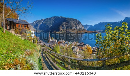 Scenic picture-postcard view of idyllic Hallstatt mountain village with famous lake Hallstatter See in the Austrian Alps on a beautiful sunny day with blue sky in fall, Salzkammergut, Austria - stock photo
