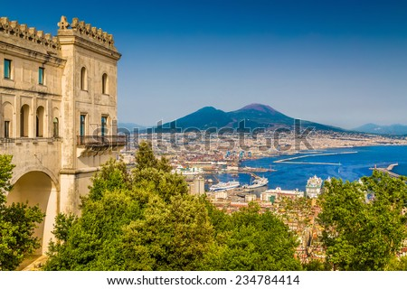 Scenic picture-postcard view of the city of Naples (Napoli) with famous Mount Vesuvius in the background from Certosa di San Martino monastery, Campania, Italy - stock photo