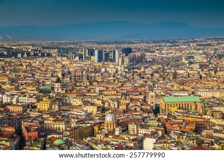 Scenic picture-postcard view of the city of Napoli (Naples) in golden evening light at sunset, Campania, Italy - stock photo