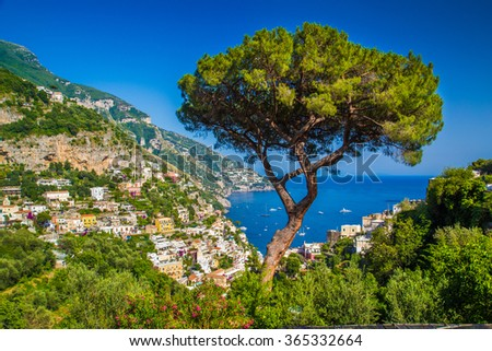 Scenic picture-postcard view of the town of Positano at famous Amalfi Coast with Gulf of Salerno in on a sunny day with blue sky, Campania, Italy