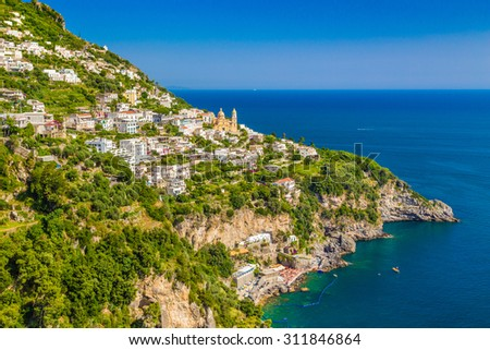 Scenic picture-postcard view of the town of Vettica Maggiore at famous Amalfi Coast with Gulf of Salerno in beautiful evening light, Campania, Italy - stock photo