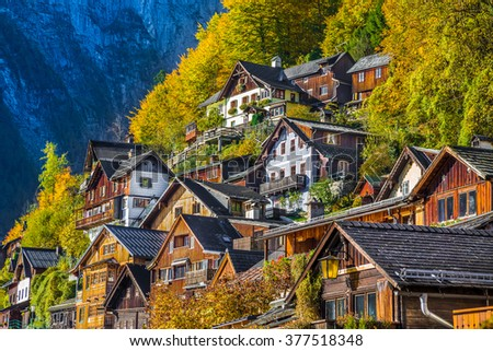 Scenic picture-postcard view of traditional old wooden houses up the hill in famous Hallstatt mountain village at Hallstatter See in the Austrian Alps in fall, region of Salzkammergut, Austria - stock photo