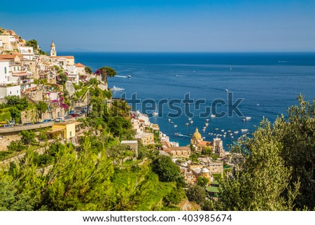 Scenic postcard view of the town of Positano with famous Church of Santa Maria Assunta at beautiful Amalfi Coast with Gulf of Salerno in beautiful evening light at sunset in summer, Campania, Italy - stock photo