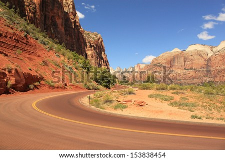 Scenic road between red rocks, Zion National Park, Utah, USA - stock photo