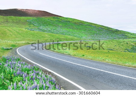Scenic road by the volcano in Iceland  - stock photo
