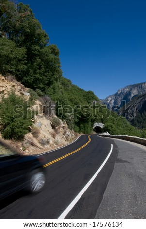 Scenic road in California with car in motion - stock photo