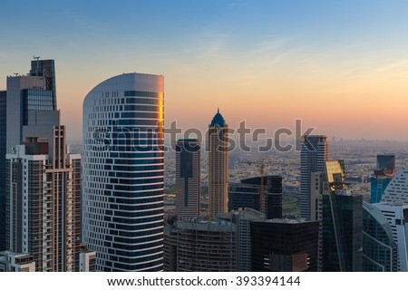 Scenic rooftop view of Dubai's business bay architecture at sunset.