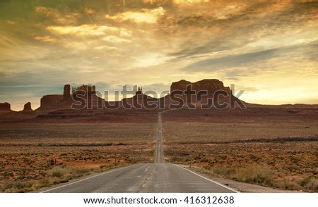 scenic route to the monument valley at sunset - stock photo