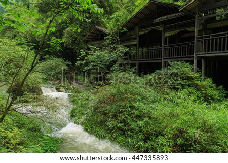 Scenic Spot along the Yangtze River/ Three Gorges Tribe buildings and river/ A river runs through a beautiful area on the Yangtze river in Yichang, China