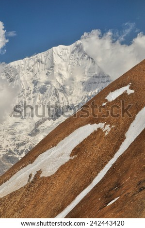Scenic steep slope in Himalayas mountains in Nepal - stock photo