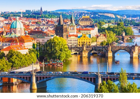 Scenic summer aerial view of the Old Town pier architecture and Charles Bridge over Vltava river in Prague, Czech Republic - stock photo
