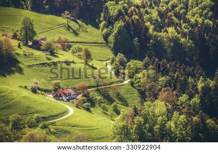 Scenic summer background. Summer mountain valley with forests, green fields and village in Germany, St. Ulrich, Black Forest - stock photo