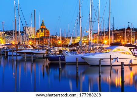 Scenic summer evening panorama of the Old Port and Uspenski Orthodox Cathedral in the Old Town in Helsinki, Finland - stock photo